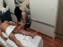 Oriental masseuse playing with clients penis