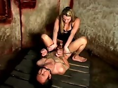 Light-haired domina pegging her slave