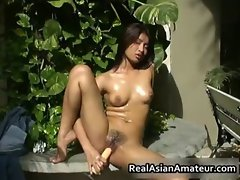 Naked Asian bombshell drills her slit