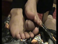 Asian women's Toes rubs the Cum out while on the Phone