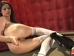Tera Patrick poses her smoldering and frothing cunt in front of the camera