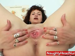 Sensual cougar in nurse uniform bizarre self exam