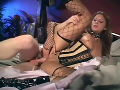 Sex in a corset sensual boots and fishnet stockings