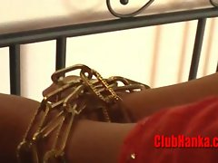 Attractive blond Mum chained