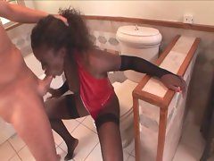Naughty ebony wench swallows phallus