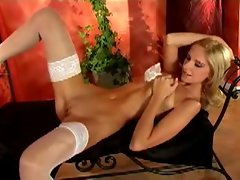 Light-haired lass in stockings strips and teases in solo