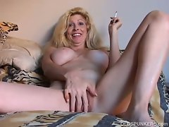 Beauteous light-haired mommy delights a smoke nude
