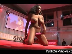Attractive and buxom slutty ebony stripper rides toy on stage