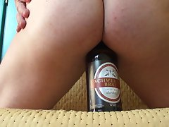 crossdresser beer bottle rectal insertion