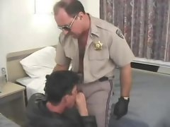 Cigar Smoking Cop licked by leather fellow