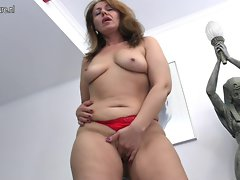 Filthy mature whore Momma getting moist by her fake penis