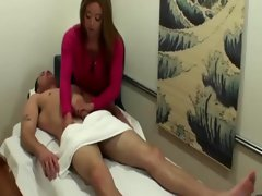 Big titted asian masseuse stroking customers balls