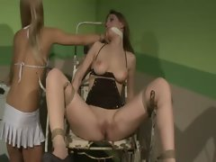Sensual blondes dominates her dark haired nympho friend as she ties her up