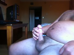 Jacking off and cumshot in a hotel