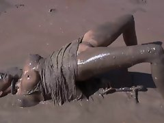 Young woman gets humiliated in the mud 1