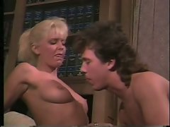 Woman prof and male student in fabulous classic sequence