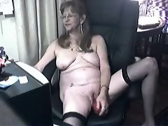 Lecher seductive granny having fun at computer. Amateur