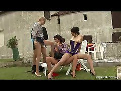 Outdoor foursome pissing act