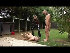 Dominant gal in latex abuses her slaves