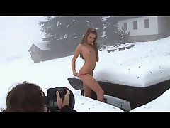 Gal doing a photo shoot in the snow