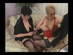 Two plump grannies in lingerie going at each other