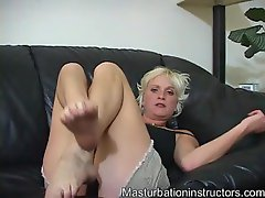 Lusty light-haired showing off her obscene feet and talking