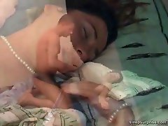 The sleeping cutie gives him a blowjob, footjob and gets shagged