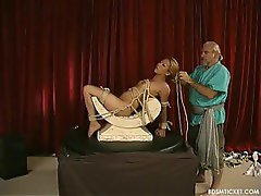 Asian babe is slowly put into painful bondage