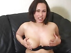 Curvy young lady showing her hooters while talking about masturbation