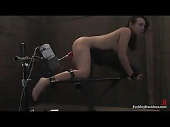Tied up lady screwed by a rubber toy machine and vibrated