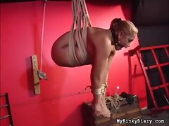 She's put in a crazy rope bondage suspension