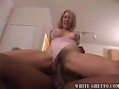 Tempting blonde filthy bitch in pinkish lace devours black fellow