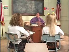 Schoolgirls on the desk having teacher sex