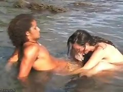 Couple playing nude and explicit in ocean
