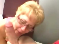 Aged granny wearing spex fellatio on shaft