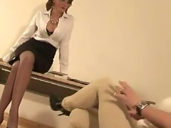 Attractive mature stocking whore femdom gives footjob