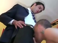 Gay lad in suit assfucks and gets stroked by computer dude
