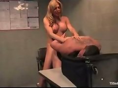 Transsexual bangs chap while he jerks penis on the table