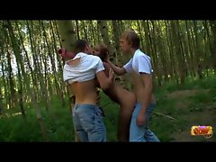 Lads double teaming a saucy teen outdoors
