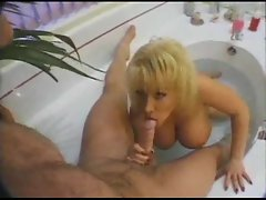 Hammering a huge tit blond in the bath