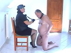 Attractive femdom act with submissive plumper hubby