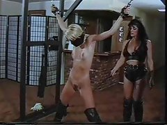 Lesbo in bondage is smacked around by a mistress