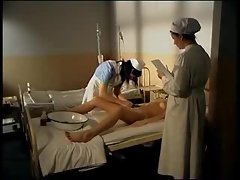 Nurses play while a man in a body cast watches