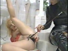 Dominatrix in black pisses on her submissive babe