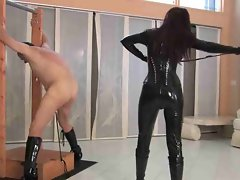 Girlie in latex catsuit whips her man brutal