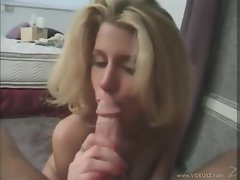 Girl on her knees giving a passionate cock sucking