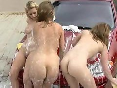 Attractive models show their knockers washing the car