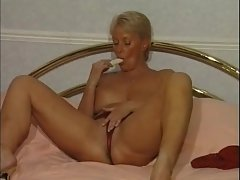Attractive mature cleans house and masturbates