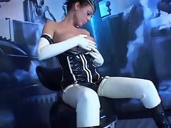 Glamorous lass in latex receives two penises