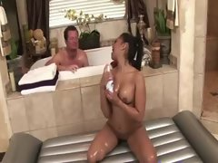 Asian slutty girl giving soapy massage to happy fellow